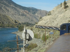 The Rocky Mountaineer rounds a bend along the Fraser River.