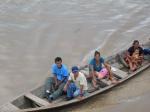 A Peruvian family passes the ship