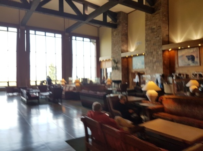 The upper lobby of the Lodge looks out on the lake and the Tetons.