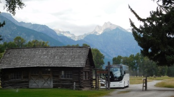 The bus parked at the entrance to the Snake River Ranch with the Tetons in the background.
