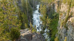 The Kepler Cascade crashes out of the forest and tumbles over many different levels in the Fire Hole River.