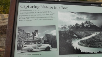 A sign commemorates the spot where Ansel Adams took his iconic photo of Grand Teton Park in 1942.