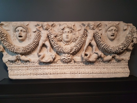 Roman sarcophagus depicting the wine harvest, associated with fertility and rebirth.