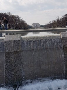 A view of the Lincoln Memorial from the fountain of the World War II Memorial.