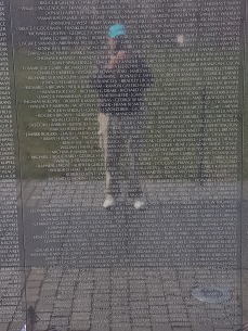 I don't do selfies, but my image is reflected in the polished granite of the memorial wall.