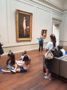 A dynamic docent teaching youngsters to appreciate art.