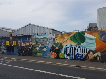 "The walls of Belfast are covered with grafitti related to the decade-long conflict they call "" the troubles,"""