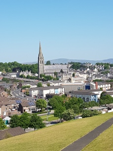 Below the walls is the bogside, 97 percent Catholic, with its cathedral in the background.