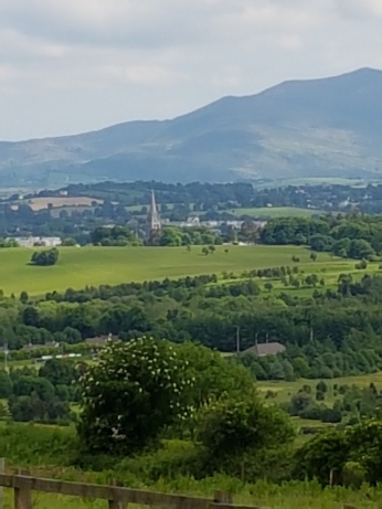 Killarney town and its church spire are seen in the distance.