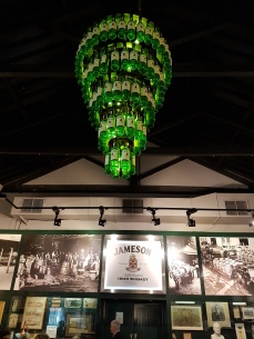 Love the chandelier made with whiskey bottles.