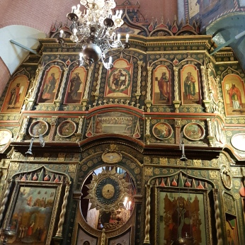 Gold-leafed icons decorate small chapels in St. Basil's.