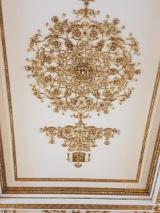 I have never before seen ceiling mouldings copied in the parquet floors of the palace.