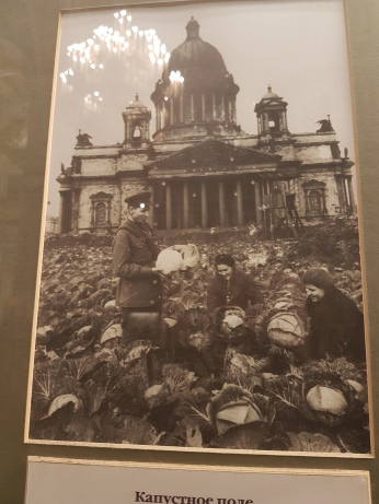 The photo in the church shows starving Russians harvesting cabbage in the cathedral square during WWII.