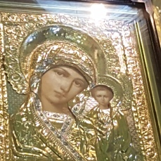 This icon of the Madonna is decorated with gold-leaf clothing.