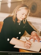 A famous visitor signing the guest book.