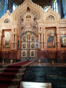 """This """" iconostatis"""" of colored Italian marble and gold-leafed bronze separates the altar from the main part of the church."""