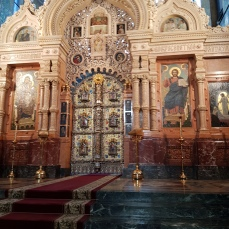 "This "" iconostatis"" of colored Italian marble and gold-leafed bronze separates the altar from the main part of the church."