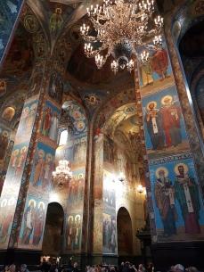 Colorful mosaics depict the saints and apostles.