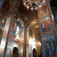 Colorful mosaics depict the saints and apostles.