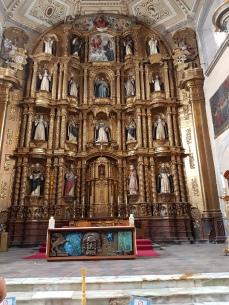 The altar retablo in the Church of Santo Domingo.