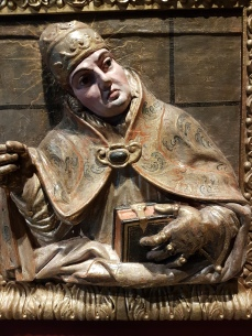 This looks like a bas-relief but it is an estofado (carved wood polychromed) of Saint Gregory.