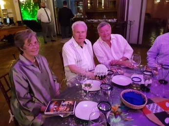 Ruth with friends David Larson and Dennis Banks at the 5th Anniversary dinner.