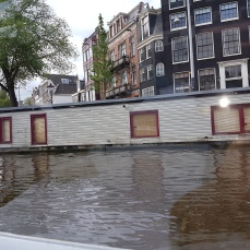 Scores of house boats line the canals.