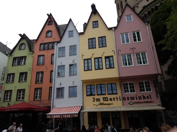 Buildings are painted in pastel colors.