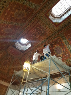 The beautiful ceiling is undergoing repair.