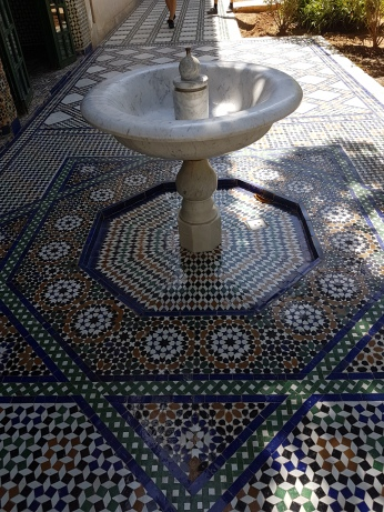 Lovely tile work and fountains are typical of Moroccan architecture.