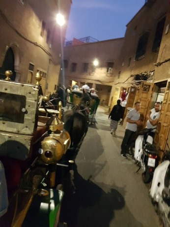 Automobiles can't traverse the narrow alleys of the medina, so carriages were the ideal way to get to restaurant Dar Zellij .