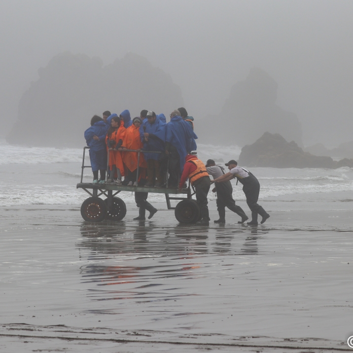 The heavy fog turned to drizzle at times. A mobile platfprm rolled us out to the boat without getting wet feet. Photo by Linda Hatfield.